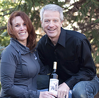 Budd with wife and wine bottle