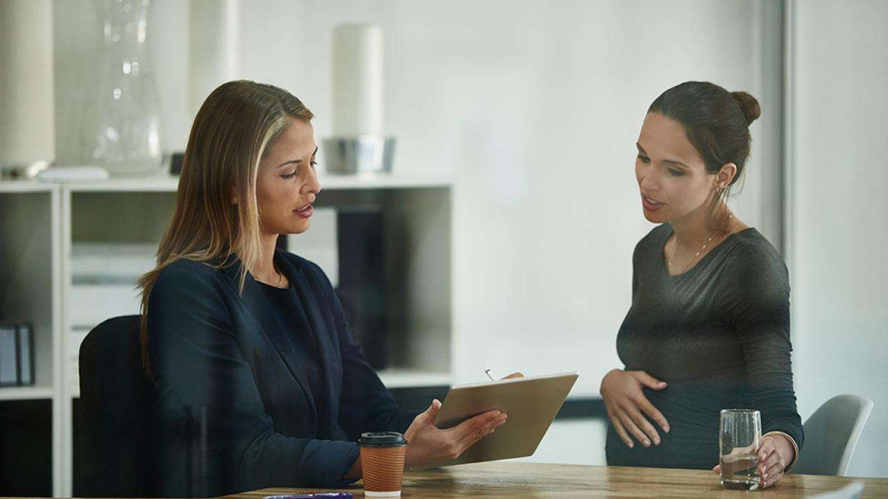 HR professional talking to pregnant employee